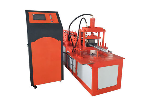 China Galvanized Iron Shutter Door Roll Forming Machine , Orange Color Door Frame Making Machine supplier